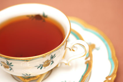 cup of black tea on biege background